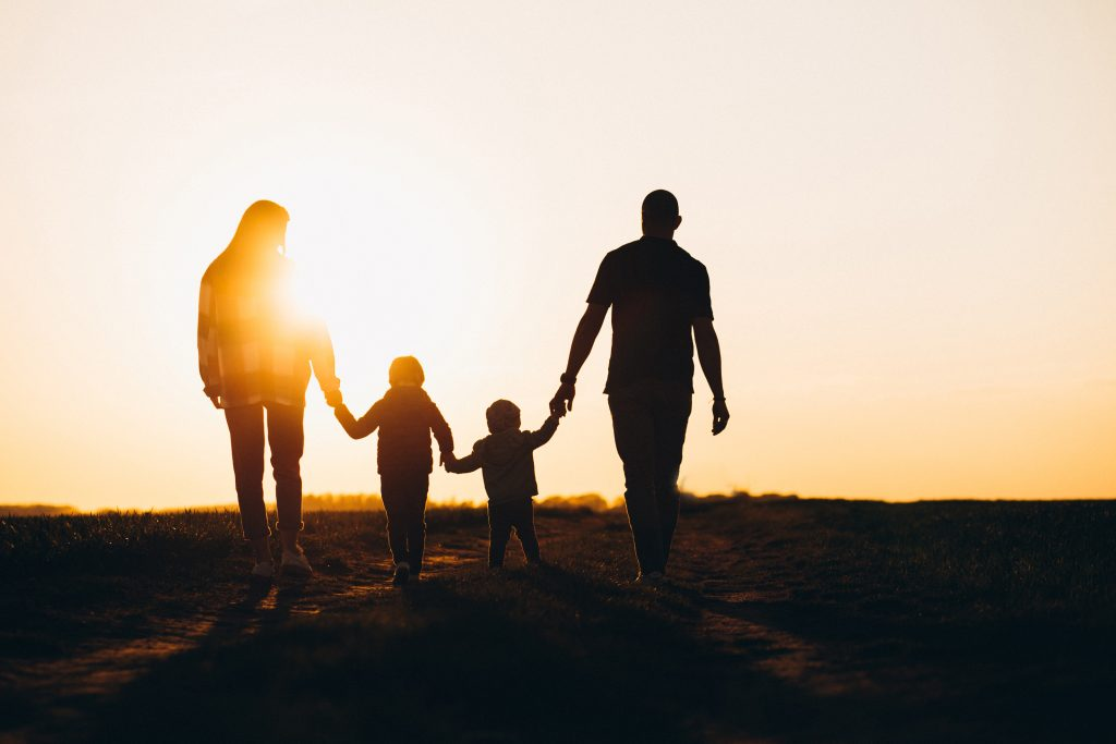 Happy family silhouette on the sunset